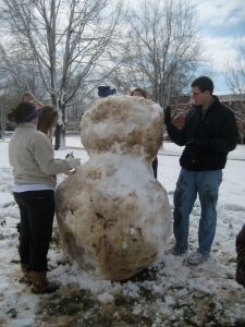 Elon students build a snowman on campus